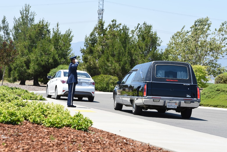 U.S. Air Force Staff Sgt. Steven C. Flynn, Travis Air Force Base Honor Guard lead instructor, salutes a hearse May 22, 2018, at Sacramento Valley National Cemetery, Calif. Travis' Honor Guard covers 45,000 sq. miles to include four National Commentaries, two VA's and every private resting area between. (U.S. Air Force photo by Airman 1st Class Jonathon D. A. Carnell)
