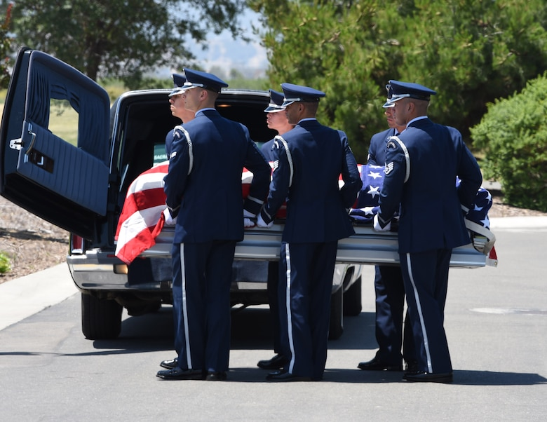 Travis Air Force Base Honor Guard member's carry a casket May 22, 2018, at Sacramento Valley National Cemetery, Calif. Travis' Honor Guard covers 45,000 sq. miles to include four National Commentaries, two VA's and every private resting area between. (U.S. Air Force photo by Airman 1st Class Jonathon D. A. Carnell)