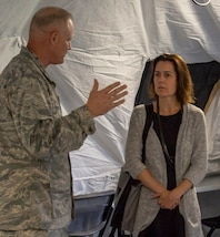 Air Force Lt. Col. Ronald Chastain, Current Operations Division chief, briefs Caroline Wadhams, senior advisor on national security and VA affairs for Senator Mark Warner (D-VA), on Early Entry Command Post operations during a visit to Joint Task Force Civil Support May 30. Wadhams and Zach Lewis, Defense legislative coordinator to Senator Warner, received briefings on command operations.  The briefings were conducted in the command's new