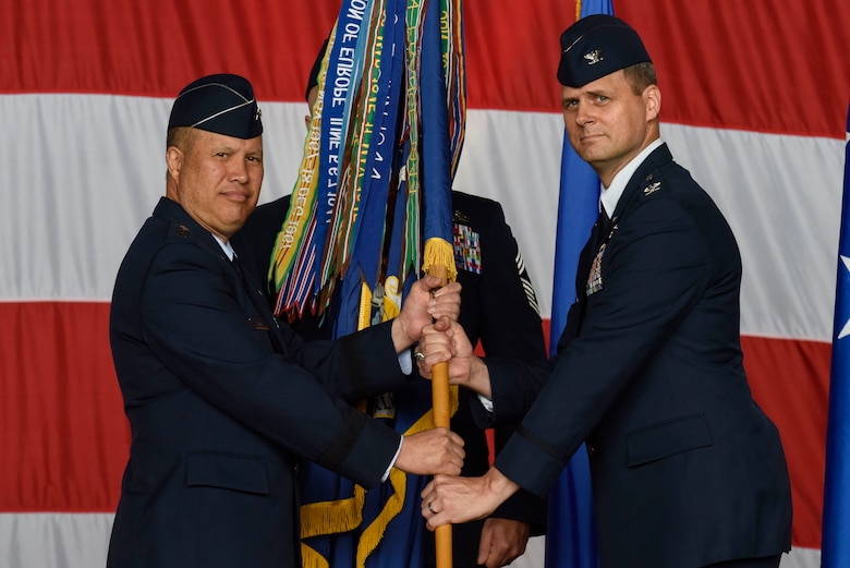 Lt. Gen. GI Tuck (left), 18th Air Force commander, presents the 436th Airlift Wing guidon to Col. Joel Safranek, incoming 436th AW commander, during a change of command ceremony May 30, 2018, at Dover Air Force Base, Del. During the ceremony, Safranek assumed command of the 436th AW becoming the wing's 34th commander. (U.S. Air Force photo by Airman 1st Class Zoe M. Wockenfuss)