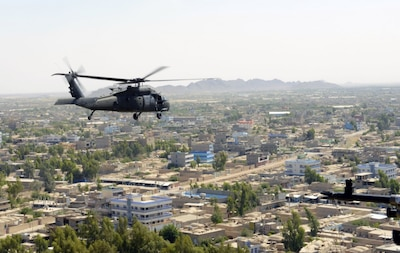 A U.S. Army UH-60 Black Hawk helicopter flies over Farah City, Afghanistan.