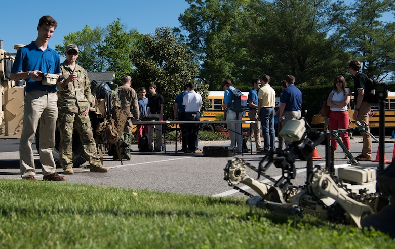 Chris Bonin, 17, a Christian Brothers Academy student, remotely controls a robot during Honor Day at the Eagle Oaks Golf and Country Club in Farmingdale, N.J., May 24, 2018. Honor Day is an annual science, technology, engineering and math exposition held during the week of Memorial Day to honor and remember fallen service members and recruit new ones. The robot is a tool used in career fields such as explosive ordnance disposal to relocate explosives without endangering others. (U.S. Air Force photo by Airman Ariel Owings)