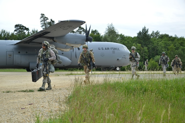 U.S. Airmen with the 621st Contingency Response Wing (CRW) dismount a C-130 Hercules during air-land operations at the Hohenfels Training Area (Germany) in support of Swift Response 16, June 16, 2016.Rescue Airmen from the 23d Wing visited the Devil Raiders of the 621st Contingency Response Wing, May 21-23, to better understand the essential assets to stand up rescue operations from bare-base situations. (U.S. Army photo by Visual Information Specialist Gertrud Zach/released)