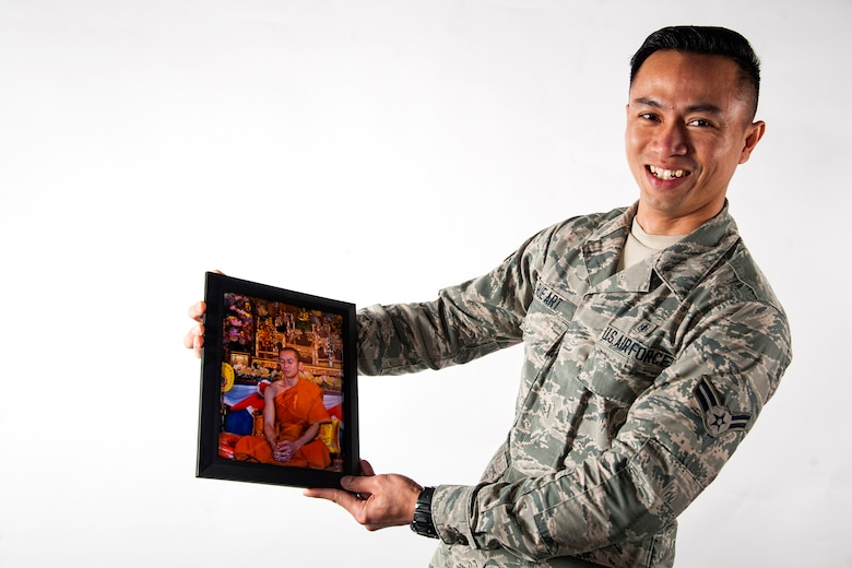 Airman 1st Class Kornkawee Rue Art, 23d Medical Support Squadron pharmacy technician, poses for a photo, March 21, 2018, at Moody Air Force Base, Ga. After spending 18 years as a monk, Rue Art traded his robes for a uniform, in his continual pursuit of a life bigger than himself; one of meaning and purpose. (U.S. Air Force photo by Airman 1st Class Erick Requadt)