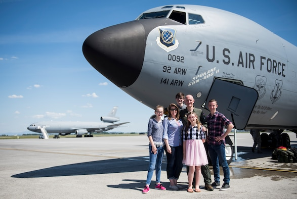 Col. Ryan Samuelson stands with his family for a photo  following his final flight as the 92nd Air Refueling Wing commander on May 14th, 2018. Samuelson is departing after two years as the 92nd ARW commander.