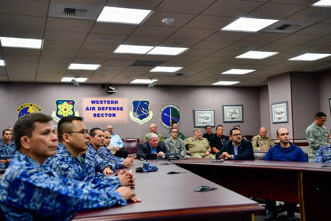 AMALGAM EAGLE 18 exercise planners from the Mexican Air Force, U.S. Air Force, Air National Guard, U.S. Customs and Border Protection, and U.S. Army receive a Western Air Defense Sector mission briefing May 22, 2018.  AMALGAM EAGLE 18 is a tactical exercise which is designed to enhance mutual warning and information sharing procedures in support of a cooperative response to illicit flights that cross the U.S.-Mexico border.