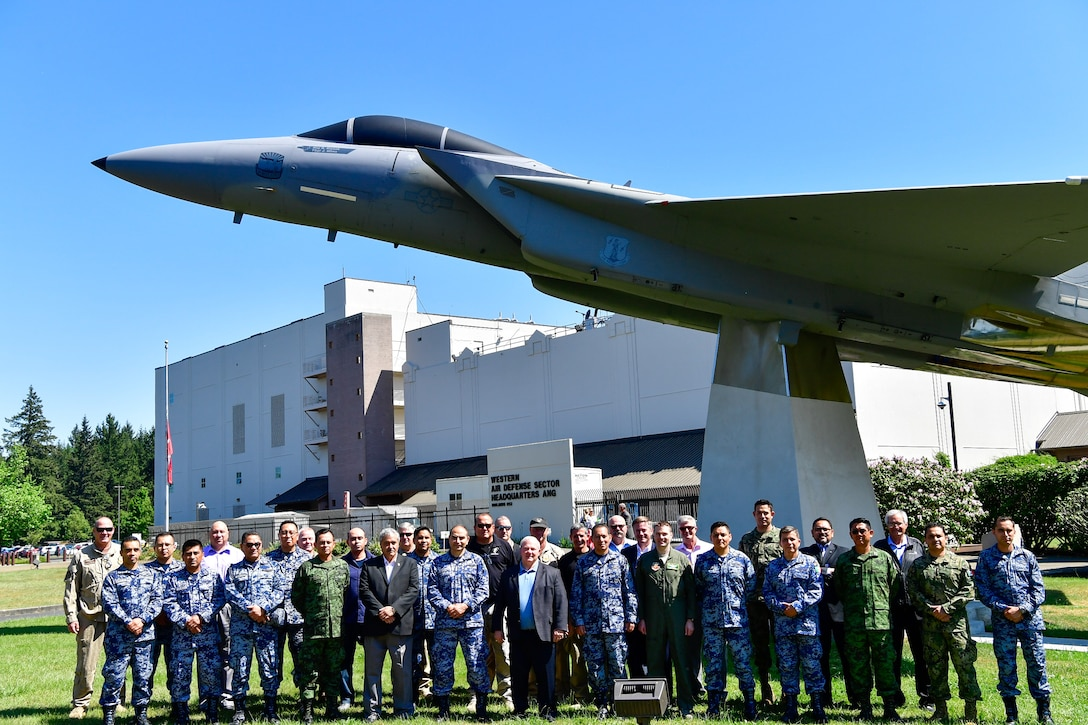 AMALGAM EAGLE 18 exercise planners take a group photo in front of the Western Air Defense Sector Air Park May 22, 2018.  AMALGAM EAGLE 18 is a tactical exercise which is designed to enhance mutual warning and information sharing procedures in support of a cooperative response to illicit flights that cross the U.S.-Mexico border.