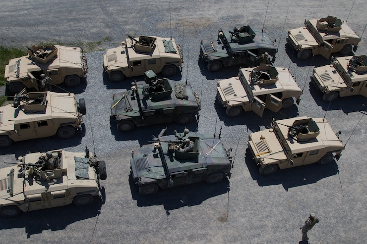Humvees lined up in rows.