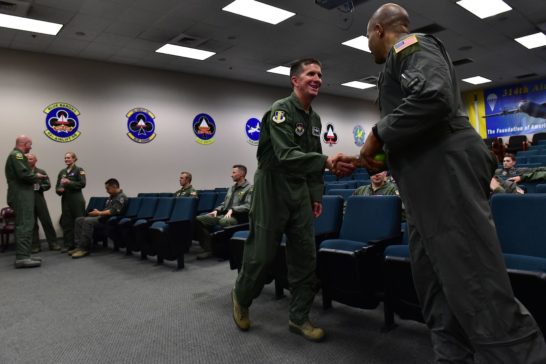 Airmen meet each other and prepare for a briefing.