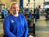 "U.S. Air Force veteran Janelle Lykon, a former air transportation noncommissioned officer, strikes a ""power"" pose during powerlifting  practice May 30, 2018, at the U.S. Air Force Academy, Colorado Springs, Colo."