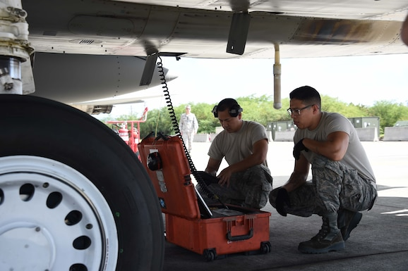 U.S. Air Force Staff Sgts. Jemson Chasengnou and Moses Sanchez, 144th Maintenance Squadron propulsion technicians, perform post-flight engine checks during Sentry Aloha 18-01 Jan. 8, 2018 at Joint Base Pearl harbor-Hickam, Hawaii.
