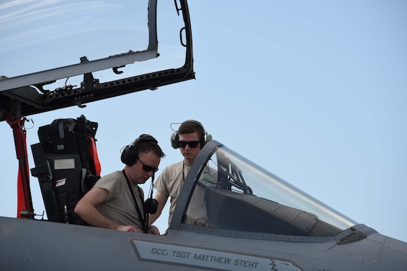 avionics technicians, perform post-flight checks on an F-15C