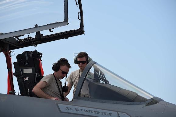 avionics technicians, perform post-flight checks on an F-15C
