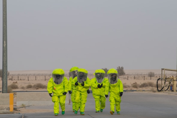 Airmen from the 386th Expeditionary Civil Engineer Squadron emergency management office walk to a decontamination site after responding to hazardous materials at an undisclosed location in Southwest Asia, May 30, 2018. The team found materials used to remove rubber from the runway. (U.S. Air Force photo by Staff Sgt. Joshua King)
