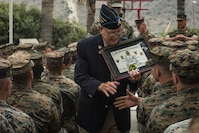 """Retired U.S. Marine Corps Chief Warrant Officer 4 Hershel """"Woody"""" Williams, the last surviving Medal of Honor recipient of the battle of Iwo Jima, shakes hands with Marines during his visit to the 5th Marine Regiment Vietnam War Memorial at Marine Corps Base Camp Pendleton, Calif., May 29, 2018. Williams visited the newly unveiled memorial to honor the Marines and sailors who gave their lives guarding our great nation."""