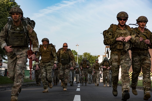 Members of the 435th Contingency Response Group begin their four mile ruck march that kicked off the 435th CRG Olympics on Ramstein Air Base, Germany, May 18, 2018. The 435th CRG is U.S. Air Forces in Europe's only expeditionary force that provides a cross-functional and rapidly deployable force designed to assess and open airbases and perform initial airfield operations.