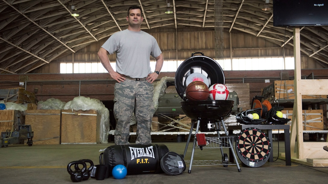 U.S. Air Force Tech. Sgt. Sydney Melton, 100th Aircraft Maintenance Squadron sortie support section chief and resiliency training assistant, poses with the community support coordinator-sponsored resiliency tools for the Airmen deployed to the 351st Expeditionary Air Refueling Squadron at Zaragoza, Spain, May 24, 2018. The 100th AMXS deployed resiliency training for the Airmen in the deployed environment, which was the first of its kind and will hopefully expand to other deployed locations. (U.S. Air Force photo by Airman 1st Class Alexandria Lee)
