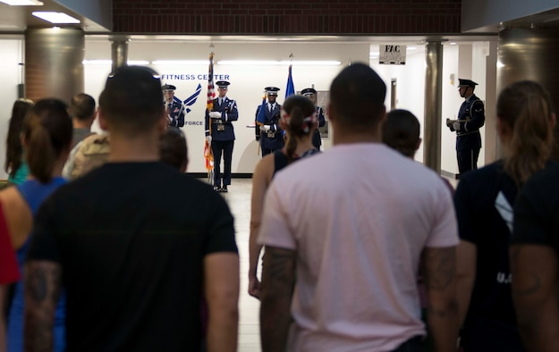 Team Shaw members stand at attention during the presentation of the colors prior to the Murph Challenge at Shaw Air Force Base, S.C., May 24, 2018.