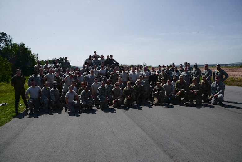Atlantic Stripe Conference participants pose for a group photo after an obstacle course on Ramstein Air Base, Germany, May 18, 2018. The Airmen were selected to attend the conference because of their potential to serve in higher leadership positions as they continue throughout their careers. (U.S. Air Force photo by Airman 1st Class D. Blake Browning)