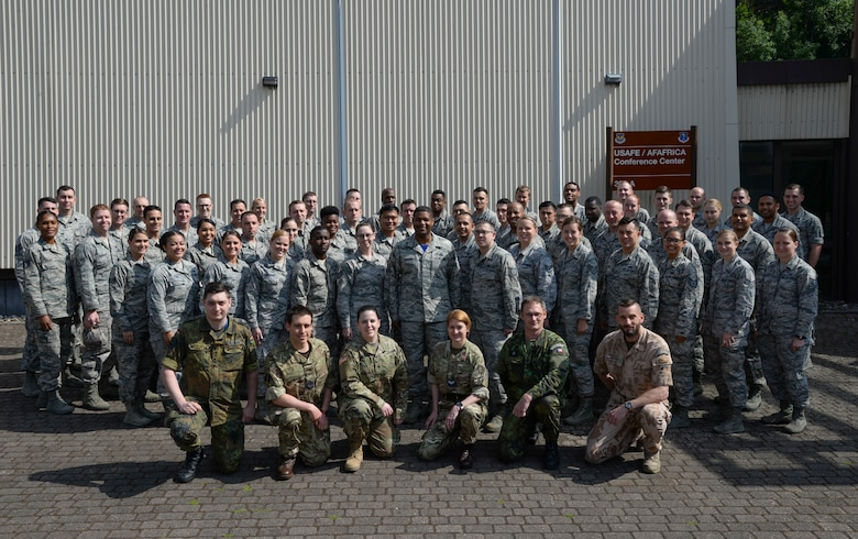 Atlantic Stripe Conference participants pose for a group photo outside the U.S. Air Forces in Europe and Air Forces Africa conference room on Ramstein Air Base, Germany, May 17, 2018. The Airmen were selected to attend the conference because of their potential to serve in higher leadership positions as they continue throughout their careers. (U.S. Air Force photo by Airman 1st Class D. Blake Browning)