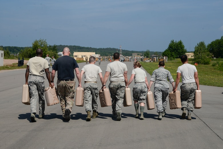 Atlantic Stripe Conference participants carry water containers as part of an obstacle course on Ramstein Air Base, Germany, May 18, 2018. With an emphasis on teamwork, leadership, and physical readiness, the obstacle course concluded the week-long conference aimed at deliberately developing noncommissioned officers. (U.S. Air Force photo by Airman 1st Class D. Blake Browning)