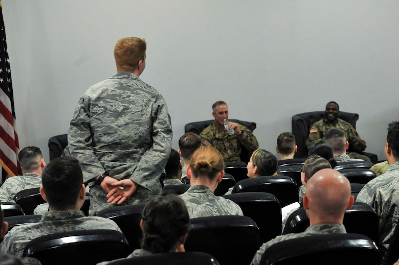 A noncommissioned officer asks a question during a panel of senior noncommissioned officers at the second annual Atlantic Stripe Conference that was held at the U.S. Air Forces in Europe and Air Forces Africa conference room on Ramstein Air Base, Germany, May 17, 2018. The conference aimed at deliberately developing junior NCOs who show potential to lead at higher levels. (U.S. Air Force photo by Airman 1st Class D. Blake Browning)
