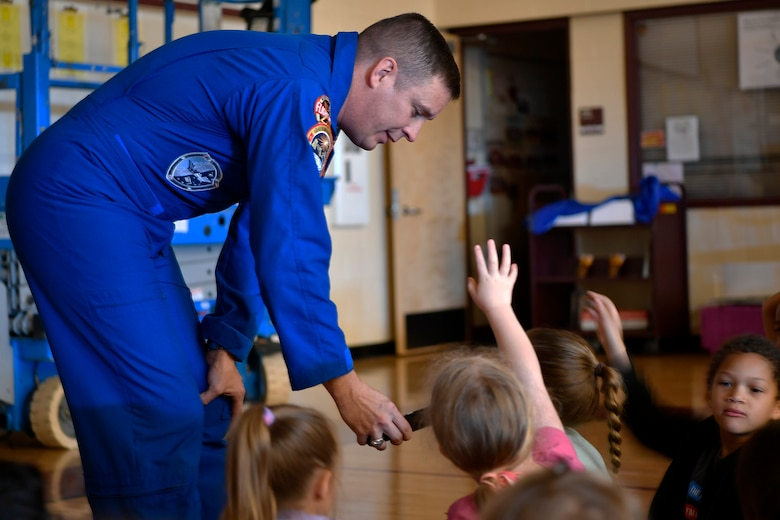 "Children ask Col. Jack ""2 Fish"" Fischer, NASA astronaut, questions about his experiences in space during a general assembly, May 22, 2018, at Aurora Quest K-8 School, Aurora, Colorado. The special guest was a surprise to the nearly 600 students in attendance.(U.S. Air Force photo by Senior Airman Madison J. Ratley)"