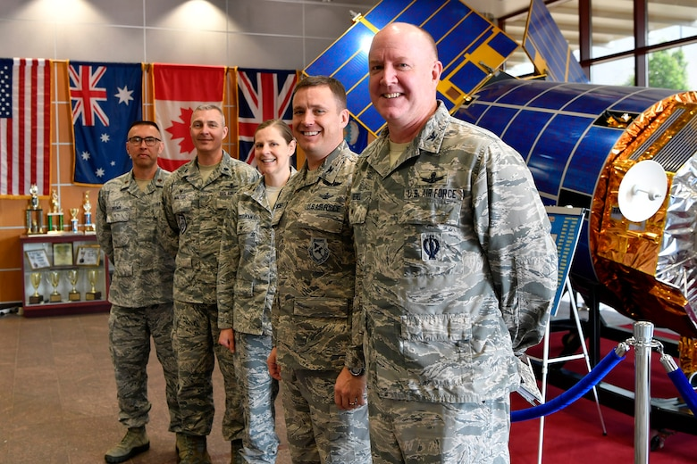 "Col. Jack ""2 Fish"" Fischer, NASA astronaut, stands with base leadership, May 22, 2018, at Buckley Air Force Base, Colorado. Fischer's tour of the installation included a luncheon at the Panther Den where he visited with Airmen of the 460th Space Wing and answered their questions about the Air Force and career opportunities. (U.S. Air Force photo by Senior Airman Madison J. Ratley)"