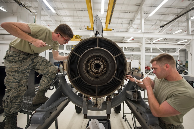 Airman 1st Class Austin Maurer, right, and Airman 1st Class Blain Gehrett, 23d Maintenance Squadron (MXS) aerospace propulsion technicians, repair a Turbo-Fan(TF)-34 engine, May 16, 2018, at Moody Air Force Base, Ga. The 23d MXS propulsion flight's mission is to ensure that the A-10C Thunderbolt II TF-34 engine is in satisfactory condition before it's even installed on the aircraft. This flight is responsible for the overall upkeep and maintenance of all TF-34 engines for the Air Force's largest operational A-10 fighter group. (U.S. Air Force photo by Airman 1st Class Eugene Oliver)
