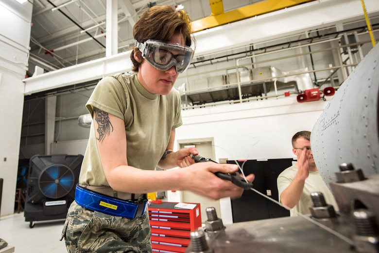 Airman 1st Class Emilie Rivera-Martinez, 23d Maintenance Squadron (MXS), aerospace propulsion apprentice, twists a wire on a Turbo-Fan (TF)-34 engine, May 16, 2018, at Moody Air Force Base, Ga. The 23d MXS propulsion flight's mission is to ensure that the A-10C Thunderbolt II TF-34 engine is in satisfactory condition before it's even installed on the aircraft. This flight is responsible for the overall upkeep and maintenance of all TF-34 engines for the Air Force's largest operational A-10 fighter group. (U.S. Air Force photo by Airman 1st Class Eugene Oliver)