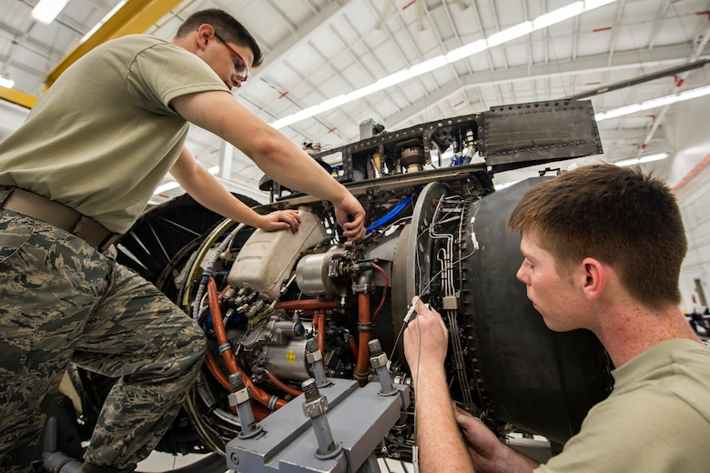 Airmen from the 23d Maintenance Squadron (MXS) aerospace propulsion flight, repair a Turbo-Fan (TF)-34 engine, May 16, 2018, at Moody Air Force Base, Ga. The 23d MXS propulsion flight's mission is to ensure that the A-10C Thunderbolt II TF-34 engine is in satisfactory condition before it's even installed on the aircraft. This flight is responsible for the overall upkeep and maintenance of all TF-34 engines for the Air Force's largest operational A-10 fighter group. (U.S. Air Force photo by Airman 1st Class Eugene Oliver)
