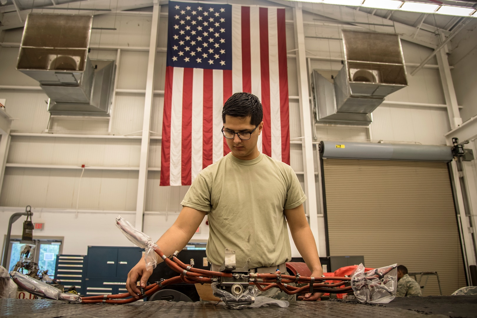 Airman 1st Class Jordan Vasquez, 23d Maintenance Squadron (MXS) aerospace propulsion technician, inspects the fuel lines of a Turbo-Fan (TF)-34 engine, May 16, 2018, at Moody Air Force Base, Ga. The 23d MXS propulsion flight's mission is to ensure that the A-10C Thunderbolt II TF-34 engine is in satisfactory condition before it's even installed on the aircraft. This flight is responsible for the overall upkeep and maintenance of all TF-34 engines for the Air Force's largest operational A-10 fighter group. (U.S. Air Force Base photo by Airman 1st Class Eugene Oliver)