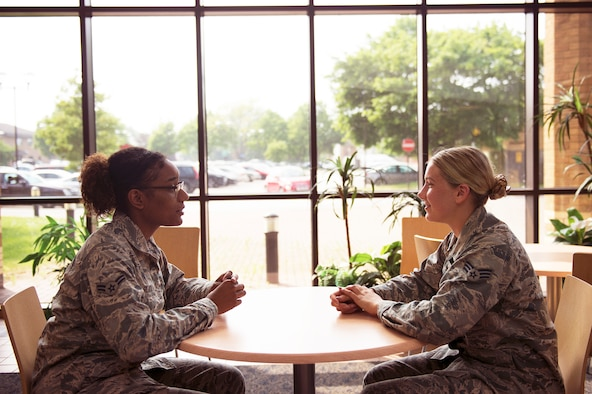 Airman 1st Class China Black (left) and Senior Airman Brianne Herklotz (right), mental health technicians assigned to the 48th Medical Group Mental Health Flight, sit and converse in the hospital reception area at Royal Air Force Lakenheath, England, May 31, 2018.  The Mental Health Flight is one resource available to assist Airmen and dependents with Mental Health concerns, and is one of three clinics in the Air Force that implements the Intensive Outpatient Program. (U.S. Air Force photo/Airman 1st Class Shanice Williams-Jones)