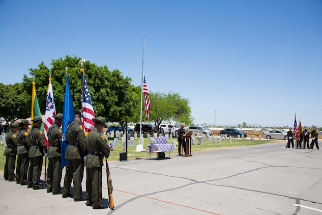 U.S. Marine Corps Col. David A. Suggs, the commanding officer of Marine Corps Air Station Yuma, Ariz., attends the Sunset Vista Memorial Day Ceremony in Yuma, Ariz., May 28, 2018. Col. Suggs participated in the ceremony as a guest speaker commemorating our fallen comrades and honoring those who have fallen in the line of duty. (U.S. Marine Corps photo by Sgt. Allison Lotz)