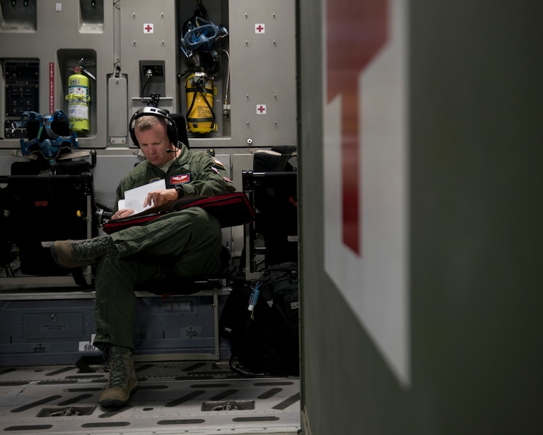 Capt. Jason Howell, 375th Aeromedical Evacuation Squadron medical crew director, reviews mission details of an AE mission in a C-17 Globemaster III at Travis Air Force Base, Calif., May 13, 2018. A 21st AS C-17 embarked on an AE mission supporting aerial transport of patients at various Air Force bases in the Pacific. (U.S. Air Force photo by Lan Kim)