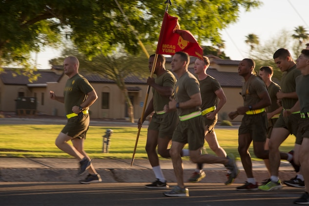 U.S. Marine Corps Lt. Col. James S. Tanis, commanding officer of Headquarters and Headquarters Squadron (H&HS), Marine Corps Air Station (MCAS) Yuma, Ariz., leads a motivational run on MCAS Yuma, Ariz., May 25, 2018. H&HS conducted the motivational run to kick off the Memorial Day 96 hour liberty period, and to say farewell to Lt. Col. Tanis who served as the commanding officer of H&HS  for the past two years. (U.S. Marine Corps photo by Sgt. Allison Lotz)