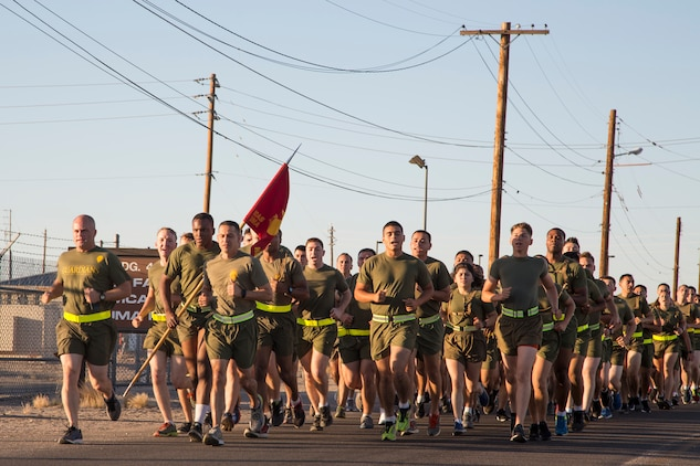 U.S. Marines stationed with Headquarters and Headquarters Squadron (H&HS), Marine Corps Air Station (MCAS) Yuma, Ariz., conduct a motivational run on MCAS Yuma, Ariz., May 25, 2018. H&HS conducted the motivational run to kick off the Memorial Day 96 hour liberty period, and to say farewell to Lt. Col. James S. Tanis. Lt. Col. Tanis served as the commanding officer of H&HS  for the past two years. (U.S. Marine Corps photo by Sgt. Allison Lotz)