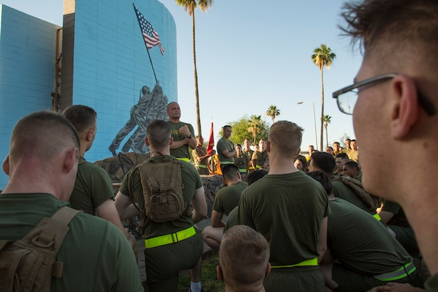 U.S. Marine Corps Lt. Col. James S. Tanis, commanding officer of Headquarters and Headquarters Squadron (H&HS), Marine Corps Air Station (MCAS) Yuma, Ariz., addresses Marines after conducting a motivational run on MCAS Yuma, Ariz., May 25, 2018. H&HS conducted the motivational run to kick off the Memorial Day 96 hour liberty period, and to say farewell to Lt. Col. Tanis who served as the commanding officer of H&HS  for the past two years. (U.S. Marine Corps photo by Sgt. Allison Lotz)