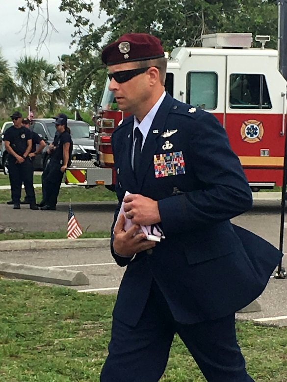 Lt. Col. Tim Hanks, 308th Rescue Squadron commander, holds an Honor and Sacrifice flag which he was presented during a Memorial Day Service at the Brevard Veterans Center to honor two of his pararescuemen who paid the ultimate sacrifice March 15, 2018 when they were killed in a helicopter crash in Iraq. MSgt. Bill Posch and SSgt. Carl Enis. (U.S. Air Force photo by Mr. Darrell Hankins)