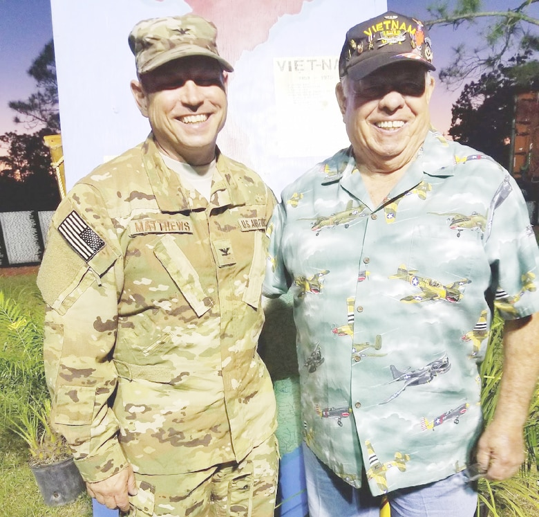 "Col. Kurt A. Matthews, 920th Rescue Wing commander, left, poses with his dad, Maj. George Matthews, Ret., a Vietnam pilot who was awarded the Silver Star and Distinguished Flying Cross for his heroics. The two men attended the Traveling Vietnam Wall in Melbourne, Florida, April 16, 2018, where Kurt Matthews was asked to speak. Kurt shared the heroics of Airmen within his wing, as well as his dad's. George Matthews flew fighter-bomber missions in the A-26 Invader over Southeast Asia to halt war supplies being transported along the Ho Chi Minh trail from Dec. 1966 - Oct. 1967. George lost his brother Aitken ""Kenny"" Matthews in Vietnam the previous year on Feb. 14, 1966. George instilled in Kurt at a young age the meaning of Memorial Day. George visits 13 friends whose names are on the wall. (Courtesy photo)"