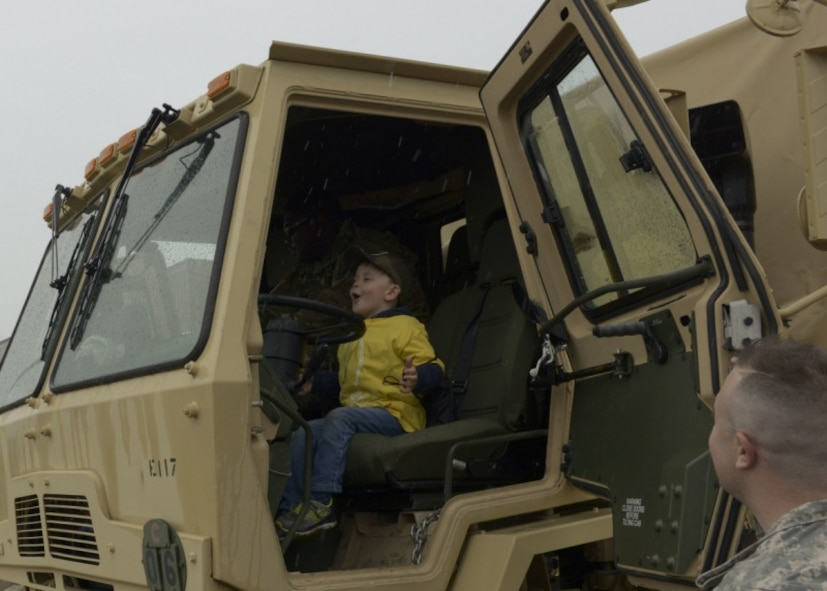 The child of a Connecticut National Guardsmen sits in the driver's seat of an Army vehicle May 19, 2018.