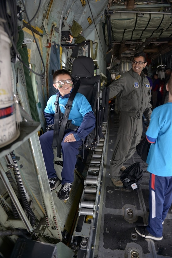 The child of a Connecticut National Guardsman sits in a C-130 Hercules May 19, 2018.