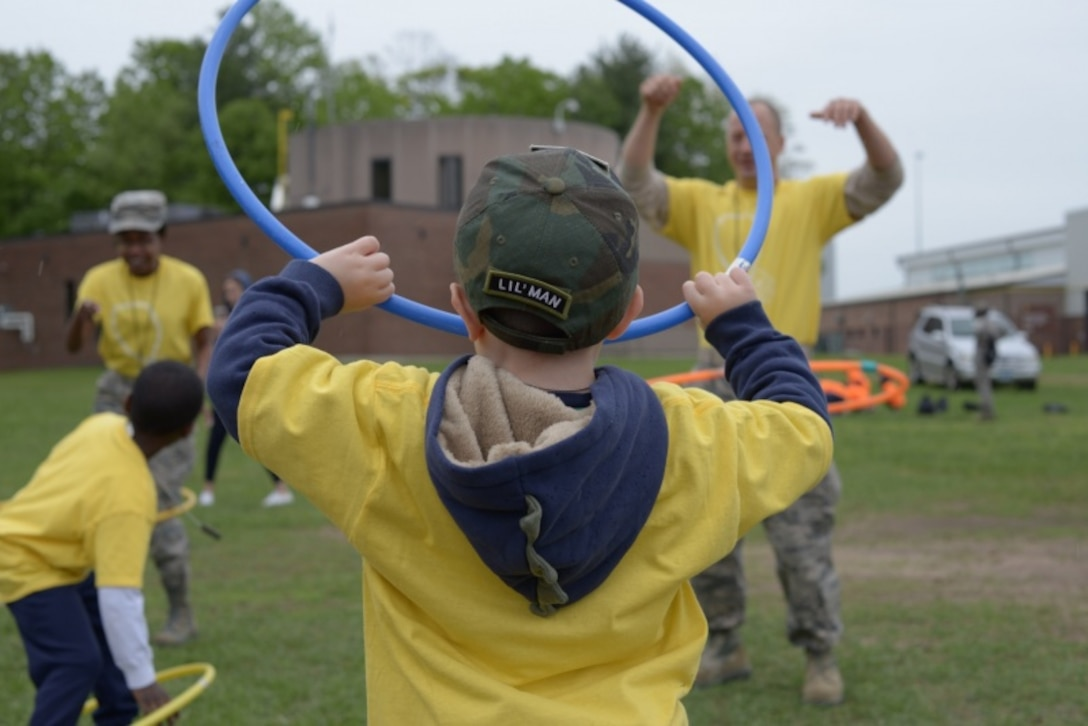 A child of a Connecticut National Guardsman learns how to hula-hoop May 19, 2018.