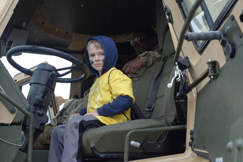 A child of a Connecticut National Guardsman sits in an Army vehicle May 19, 2018.