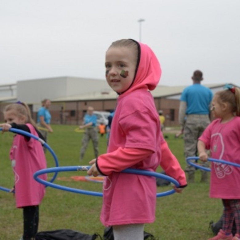 Children of Connecticut National Guardsmen learn how to hula-hoop May 19, 2018.