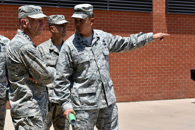 U.S. Air Force Lt. Col. Abraham Salomon, 17th Training Support Squadron commander, speaks with Gen. Mike Holmes, Commander of Air Combat Command, on Goodfellow Air Force Base, Texas, May 30, 2018. Holmes visited Goodfellow to understand the intelligence, surveillance, reconnaissance training and to meet with San Angelo civic leaders. (U.S. Air Force photo by Senior Airman Randall Moose/Released)