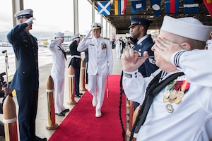 Navy Adm. Philip S. Davidson, left, shakes hands with Navy Adm. Harry B. Harris during a change-of-command ceremony.