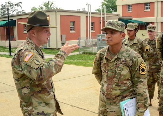 Army Staff Sgt. Joseph D. Moore gives instruction to Army Pvt. Marc Marmeto