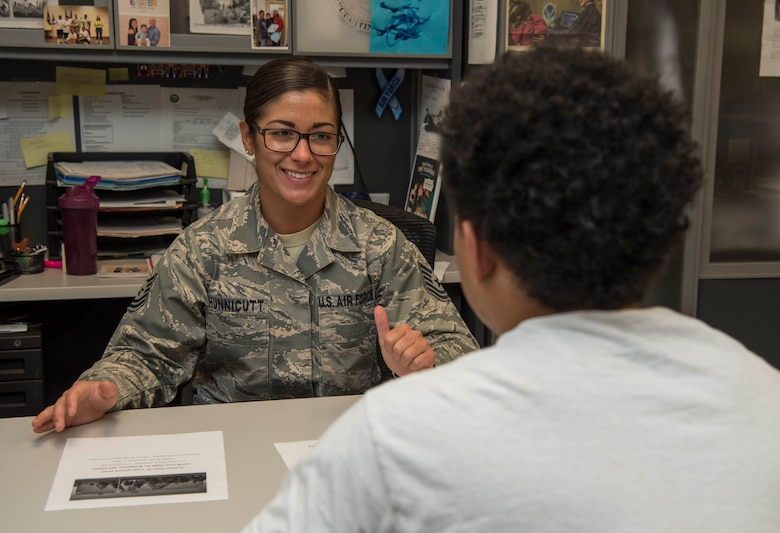 Tech. Sgt. Merissa Hunnicutt, 345th Recruiting Squadron recruiter, speaks with a recruit about the Military Entrance Processing Station, May 14, 2018, at the Air Force Recruiting Office, Faiview Heights, Illinois. The 345th RCS is on track to enlist approximately 1,100 new Airmen this year. (U.S. Air Force photo by Senior Airman Melissa Estevez)