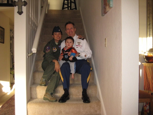 Lt. Col. An Duong, the 28th Medical Group chief of aerospace medicine, sits with her family in their home in Ohio in 2014. Duong was born in Vietnam, but moved to the United States and became a medical professional before commissioning into the Air Force. (Courtesy photo)